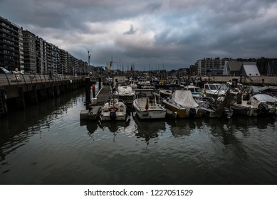 Blankenberge, Flanders / Belgium - 10 30 2018: View over the small sea harbor with rainy clouds in the background