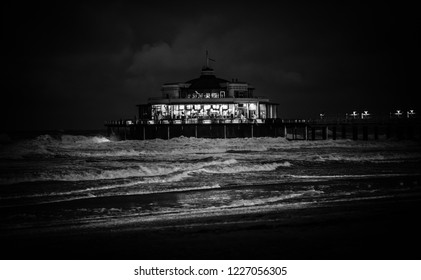 Blankenberge, Flanders / Belgium - 10 30 2018: Pier and lighthouse at night with stormy weather