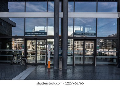 Blankenberge, Flanders / Belgium - 10 30 2018: People walking from and to the railwaystation at the Leopold III square