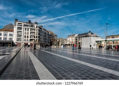 Blankenberge, Flanders / Belgium - 10 30 2018: People walking  at the Leopold III square near the railwaystation