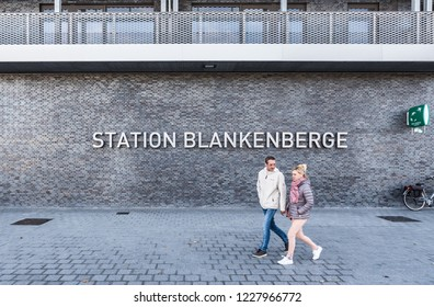 Blankenberge, Flanders / Belgium - 10 30 2018: Mid aged couple walking next to the railwaystation at the Leopold III square