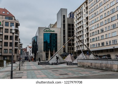 Blankenberge, Flanders / Belgium - 10 30 2018: A few tourists and walking in the rain to the Casino