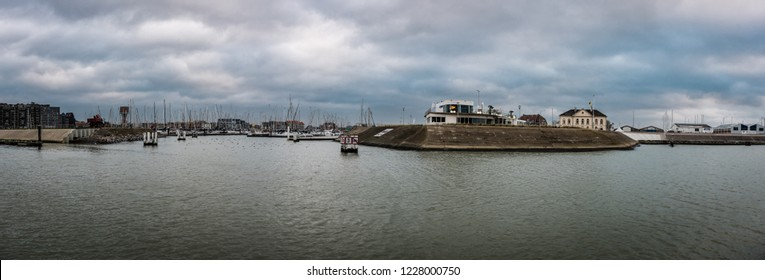 Blankenberge, Flanders / Belgium - 10 30 2018: Wide panoramic view over the port with heavy clouds in the background