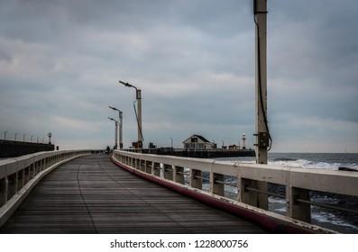 Blankenberge, Flanders / Belgium - 10 30 2018: Empty wooden pier during rainy weather