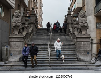 Blankenberge, Flanders / Belgium - 10 30 2018: Mature tourists walking down the stairs from the beach towards downtown