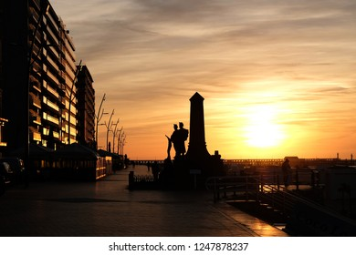 Blankenberge/Belgium- 10.08.2018: monument to the soldiers on the seafront at Blankenberg in the rays of the setting sun