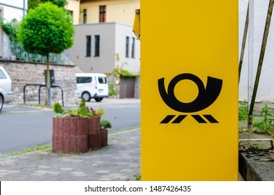 Blankenheim, Germany - July 26, 2019: Deutsche Post Mailbox. The Deutsche Post AG, operating under the trade name Deutsche Post DHL Group, is a German postal service and international courier service.