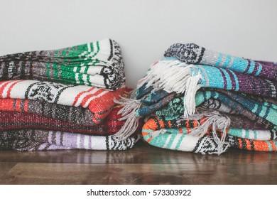 Blankets folded on the floor.