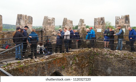Blarney / Ireland - May 20, 2018: People lined up to kiss the Blarney Stone at Blarney Castle, Blarney, Ireland, on May 20, 2018.