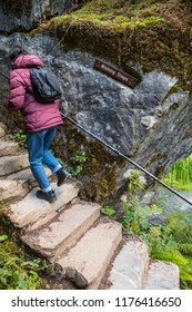 Blarney, Republic of Ireland - August 16th 2018: A visitor climbing the Wishing Steps at the historic Blarney Castle in Blarney, Republic of Ireland.