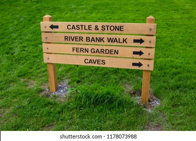 Blarney, Republic of Ireland - August 16th 2018: Signposts at the historic Blarney Castle in Republic of Ireland, showing direction for the Castle, River Bank Walk, the Fern Garden and Caves.