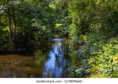 Blarney, Republic of Ireland - August 16th 2018: A view of the river that runs through the beautiful gardens at Blarney Castle in the Republic of Ireland.