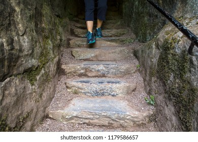 Blarney, Republic of Ireland - August 16th 2018: A visitor walking down the Wishing Steps at the historic Blarney Castle in Blarney, Republic of Ireland.