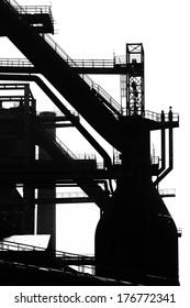 Blast furnace silhouette at heavy steel machinery