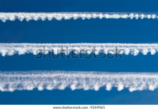 Blast pattern in a blue sky
