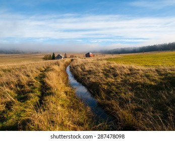 Blatna irrigation canal in the middle of autumn mountains, Czech Republic