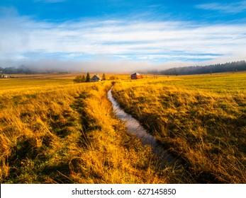 Blatna irrigation canal in the middle of autumn landscape near Ryzovna, Ore Mountains, Czech Republic.