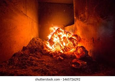 Blaze fire flame in stove, orange and black