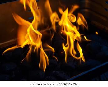 Blazing charcoal on outdoor grills racket.