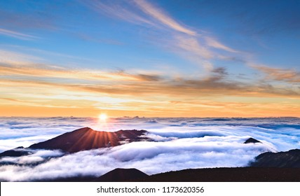 A blazing and colorful morning sunrise over the crater of the dormant volcano Haleakala on the island of Maui, Hawaii