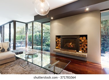 Blazing fire in living room of luxury architect designed Australian house