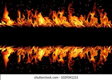 Blazing flames over black background
