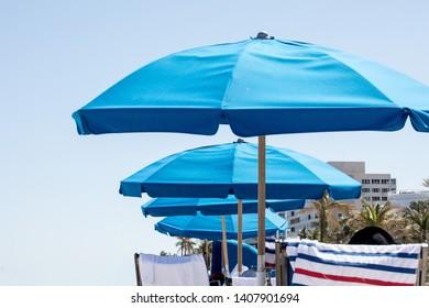 Ble beach umbrellas at the seaside