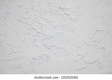 Bleached old plastered wall with cracks. Attrition. White grayscale background. Black and white texture.