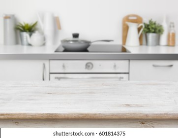 Bleached wooden texture table on defocused kitchen bench interior background