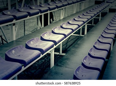 Bleachers in a football stadium, detail of a sports venue, seating for spectators