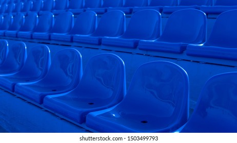 Bleachers in a sports stadium. Blue Seats In A Row