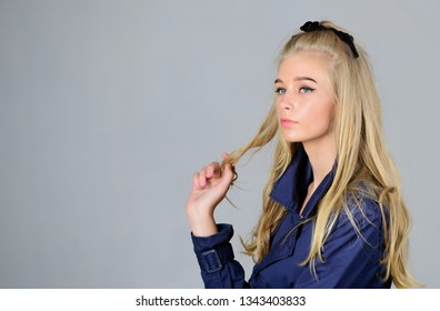 Bleaching roots. Hairdresser tips concept. Salvaged my bleached hair. How to take care of bleached hair. Girl tender blonde makeup face grey background. How repair bleached hair fast and safely.
