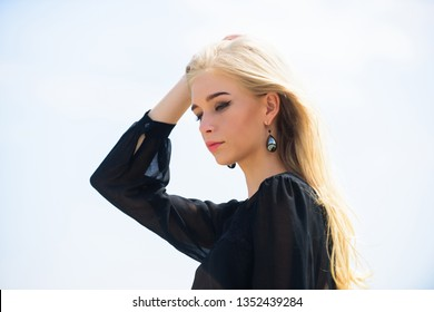 Bleaching roots. Hairdresser tips concept. Salvaged my bleached hair. How to take care of bleached hair. Girl tender blonde makeup face sky background. How to repair bleached hair fast and safely.