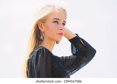 Bleaching roots. Salvaged my bleached hair. How to take care of bleached hair. Girl tender blonde makeup face sky background. How to repair bleached hair fast and safely. Hairdresser tips concept.