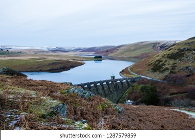 The bleak moorland and water landscape of the Elan Valley in winter. With the Victorian dam of the Craig Goch Reservoir