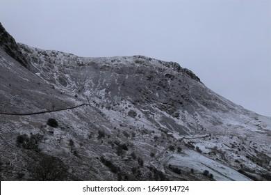A bleak snowy peak at the end of the Cadair Idris Range, from the Tal-y-llyn Pass, Gwynedd, Wales, UK.