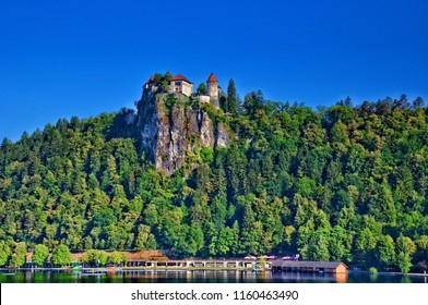 Bled Castle, Slovenia. Bled Castle is a medieval castle built on a precipice above the city of Bled, overlooking Lake Bled. According to written sources, it is the oldest Slovenian castle.