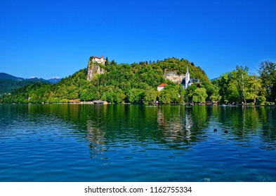 The Bled Castle surrounded by Lake Bled, Slovenia. Lake Bled is a lake in the Julian Alps in northwestern Slovenia. The World Rowing Championships were held there several times.