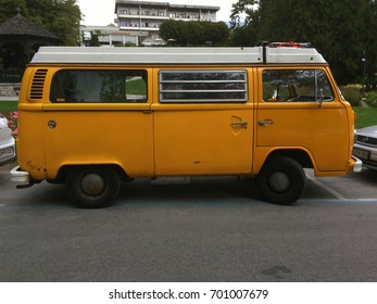 Bled, Gorenjsk, Slovenia - August 6, 2017: Yellow Volkswagen (VW) Transporter Type 2 parked by the side of the road in the city of Bled. Nobody in the vehicle.