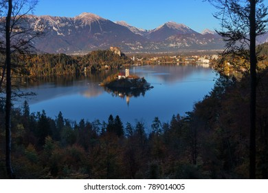 Bled Lake and island in Slovenia seen from above during a sunny autumn day.