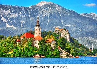 Bled lake,island with Pilgrimage Church of the Assumption of Maria and the famous old castle on the cliff.Bled lake Slovenia,Europe