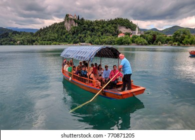 Bled Slovenia - 13 July 2017:  Unidentified people on a boat in Lake Bled on July 13, 2017 in Bled, Slovenia.