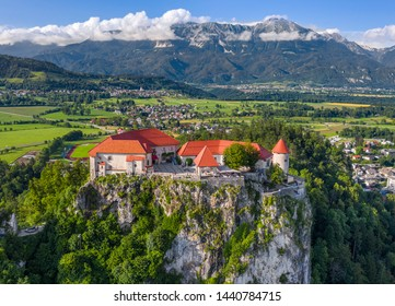 Bled, Slovenia - Aerial view of beautiful Bled Castle (Blejski Grad) with the Julian Alps and blue sky at background at summer time