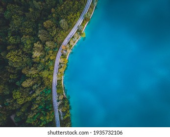Bled, Slovenia - Aerial view of beautiful Pilgrimage Church at Lake Bled. Raod near the lake with blue water. Aerial shot.