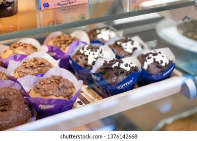 Bled, Slovenia - April 14, 2019 : A photo of  famous branded chocolate cupcakes selling in the supermarket including milka chocolate muffins and oreo flavour cupcakes.