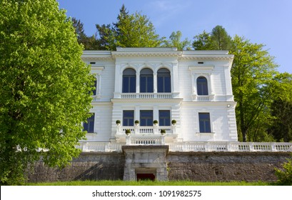 BLED, Slovenia - April 25, 2018: Elegant neoclassic building surrounded by a beautiful park just over the lake