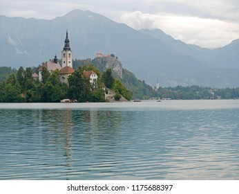 Bled, Slovenia - August 11, 2018: The Assumption of Mary Pilgrimage Church was built on an island in the middle of Lake Bled, Slovenia in the Middle Ages and remains a popular tourist attraction.