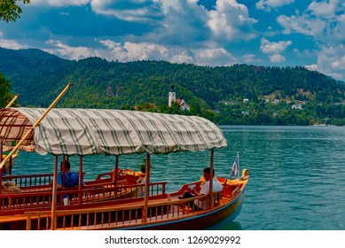 Bled, Slovenia - August 19 2018: panorama of the crystal clear waters of Lake Bled, a tourist resort in Slovenia famous for its small island with its church
