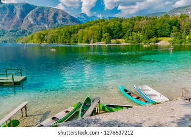 Bled, Slovenia - August 22 2018: boats and kayaks in the transparent waters of Lake Bled in Slovenia during the hot summer