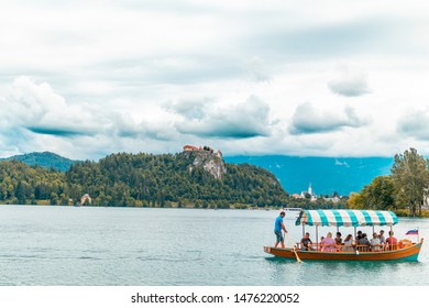 Bled/Slovenia-August 01, 2019: Tourists on boat  on lake bled in Slovenia